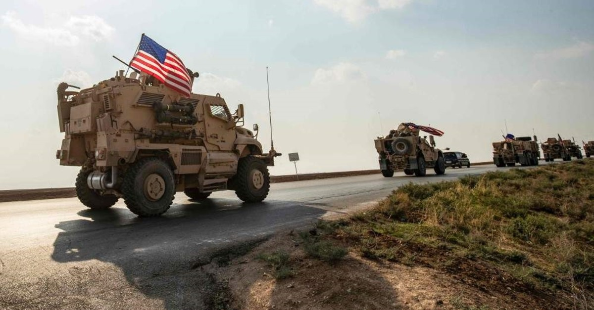 A convoy of US military vehicles, arriving from northern Iraq, passes through the Syrian northeastern city of Qamishli towards the eastern region of Deir Ezzor on October 26, 2019. (AFP Photo)