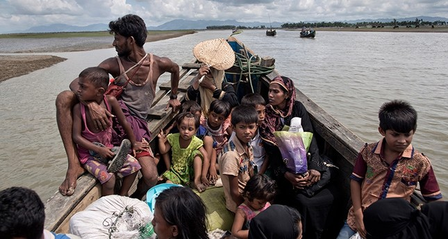 In this Oct. 2, 2017 photo, newly arrived Rohingya refugees on a boat towards a Bangladesh army run processing center where they will be allotted their camp, in Shah Porir Dwip, Bangladesh. (AP Photo)