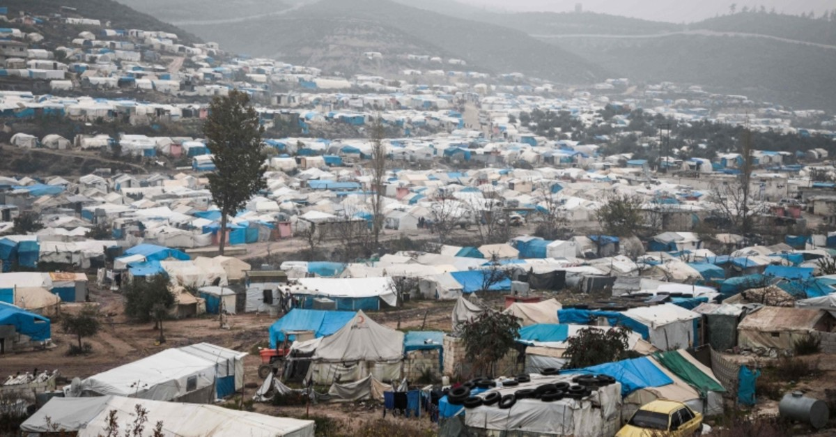 In this file photo taken on December 12, 2019 shows a view of tents at a camp for displaced Syrians at Khirbet al-Joz in the west of the northwestern Idlib province near the border with Turkey. (AFP Photo)