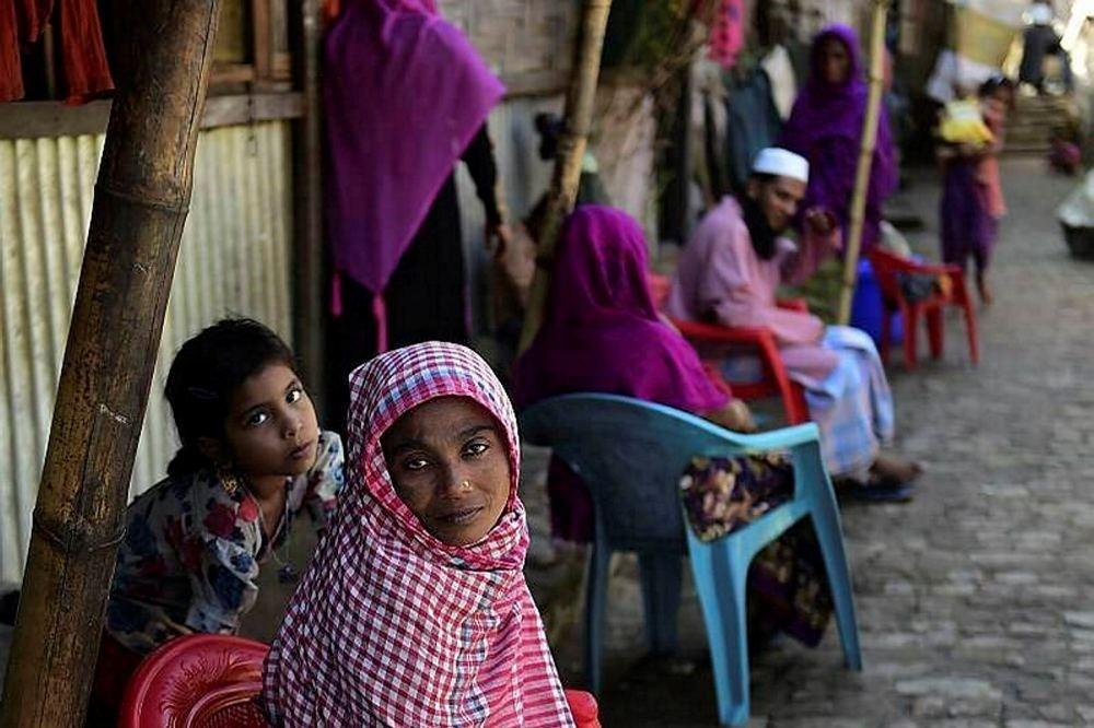 Rohingya refugees look on in a refugee camp in Teknaf, in Bangladesh's Cox's Bazaar.