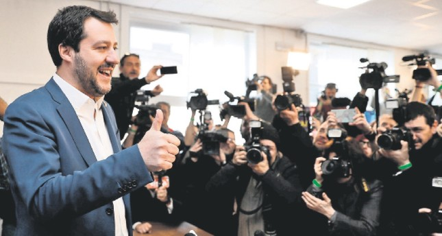 The head of the antiestablishment Northern League, Matteo Salvini, gives a thumbs-up as he arrives for a press conference, Milan, Italy, March 5.