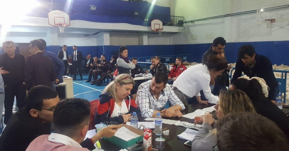 In this undated picture officials from the YSK and different political parties recount votes in the Istanbul Metropolitan Municipality elections, following objections of irregularities.