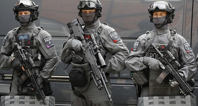 Police counter terrorism officers pose during a media opportunity in London, Wednesday, Aug. 3, 2016. (AP Photo)