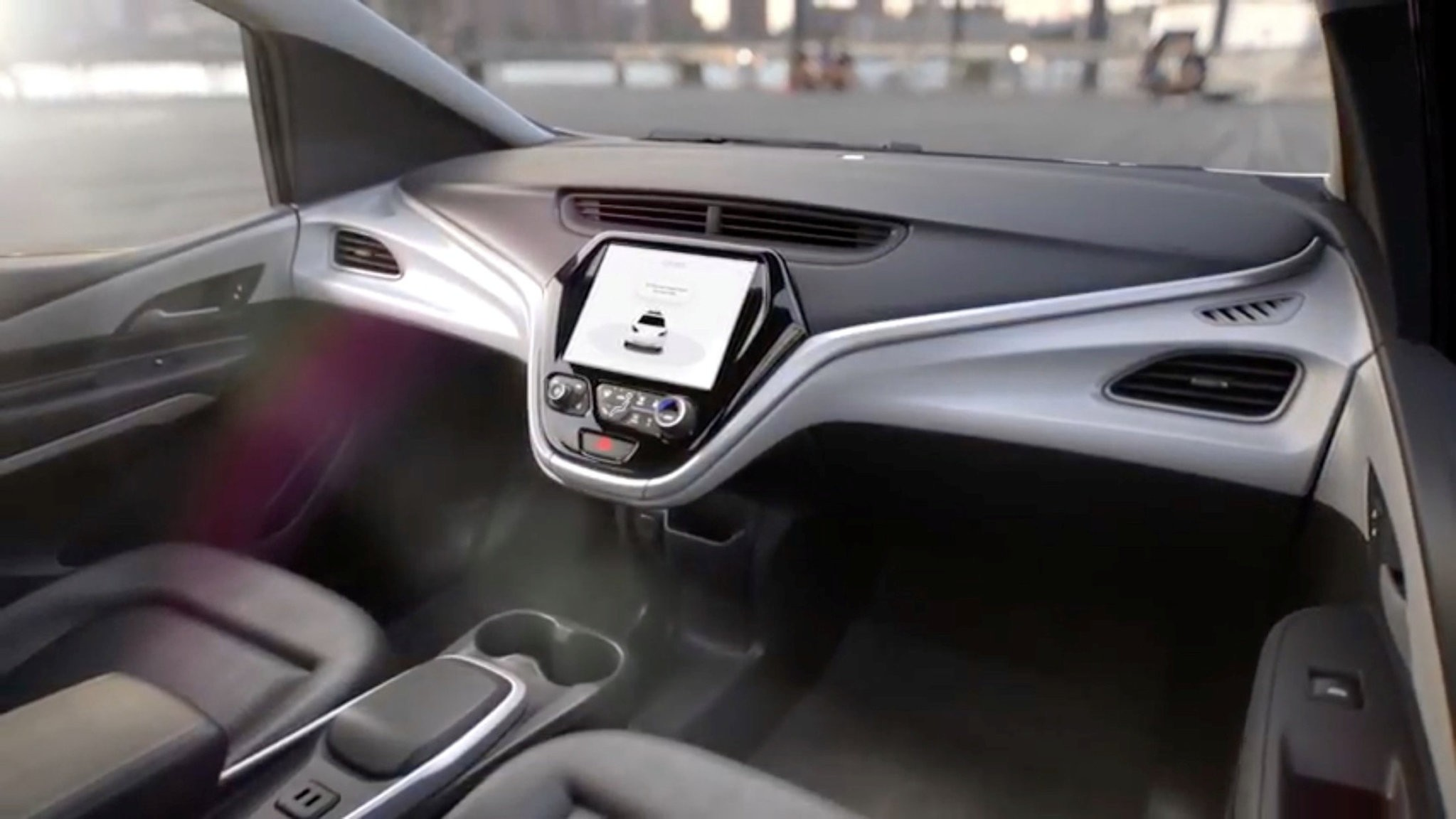 GMu2019s planned Cruise AV driverless car features no steering wheel or pedals in a still image.