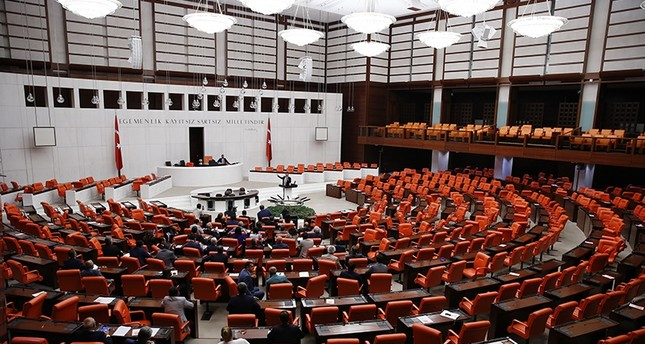 Opposition CHP lawmakers protesting the draft law at the Grand National Assembly of Turkey (TBMM), Thursday July 24, 2017 (AA Photo)
