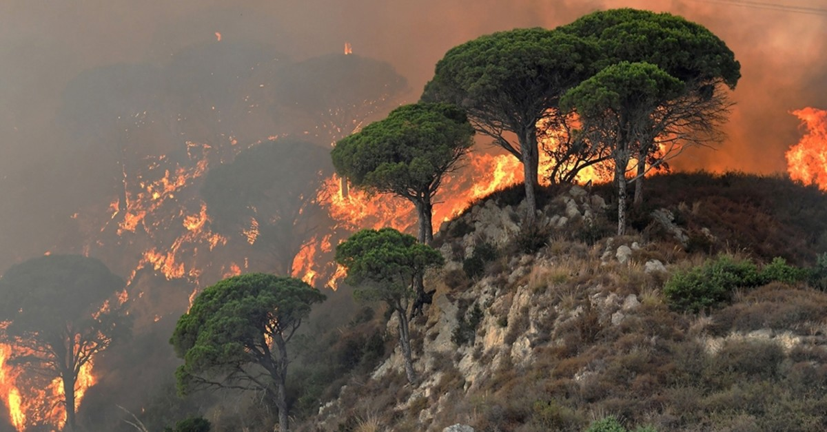 A fire ravages a hill in the Annunziata district of Messina, Italy, on July 10, 2017. (AFP Photo)