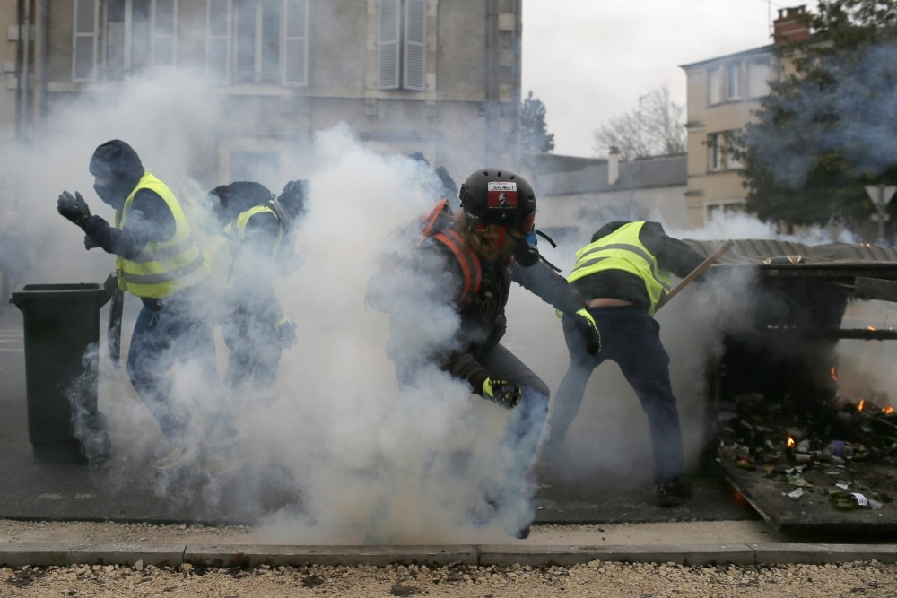 French police fire tear gas as ,yellow vest, demonstrators set up barricades in Bourges, Jan. 12, 2019.