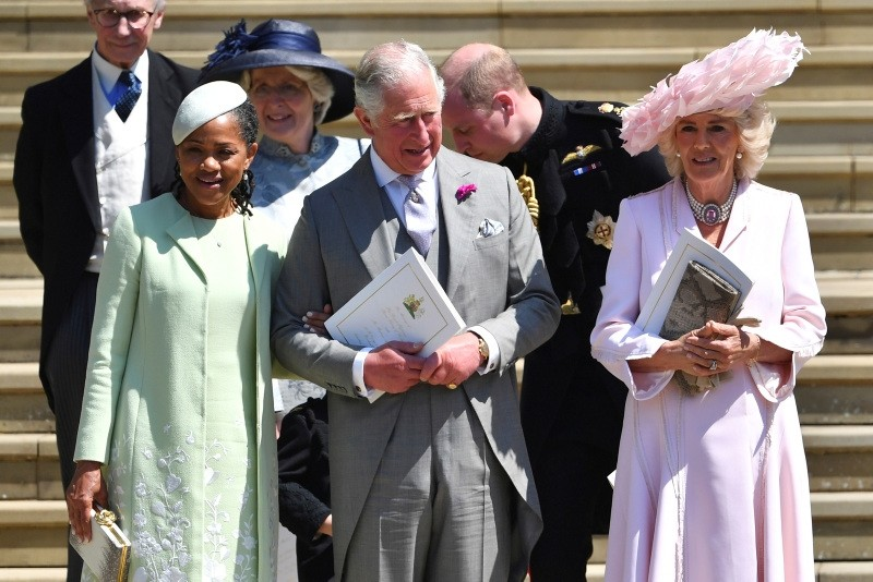 From left, Doria Ragland, Britain's Prince Charles, Prince William, background and  Camilla, Duchess of Cornwall, leave after the wedding ceremony of Prince Harry and Meghan Markle, at St. George's Chapel in Windsor Castle in Windsor, near London, England, Saturday, May 19, 2018.
