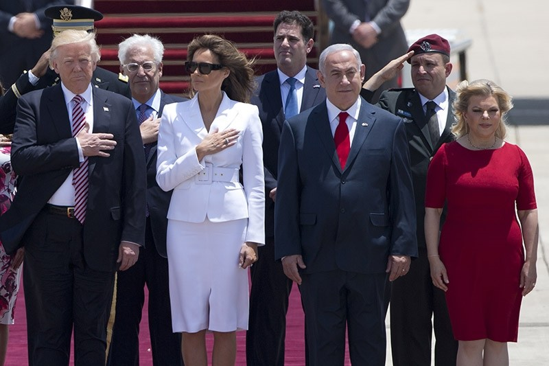 US President Donald Trump and his wife Melania, and Israeli Prime Minister Benjamin Netanyahu and his wife Sara stand during welcome ceremony in Tel Aviv, Monday, May 22,2017. (AP Photo)