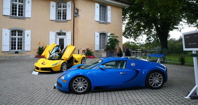 A Ferrari LaFerrari 2015 and a Bugatti Veyron EB 16.4 Coupe 2010 pictured during an auction preview of Bonhams at the Bonmont Golf & Country Club in Cheserex near Geneva, Switzerland September 27, 2019. Reuters Photo