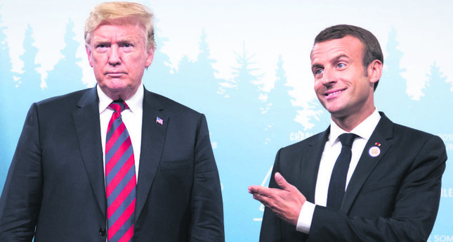 U.S. President Donald Trump and French President Emmanuel Macron hold a meeting on the sidelines of the G-7 Summit in Charlevoix, Quebec, Canada, June 8.