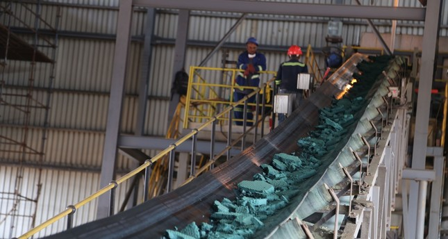 A conveyor belt carries chunks of raw cobalt after a first transformation at a plant in Lubumbashi before being exported to be refined, mainly to China.