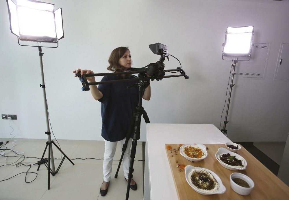 Alia Adi, founder of the YouTube cooking channel Basmaty World, works in her studio in Dubai, United Arab Emirates.