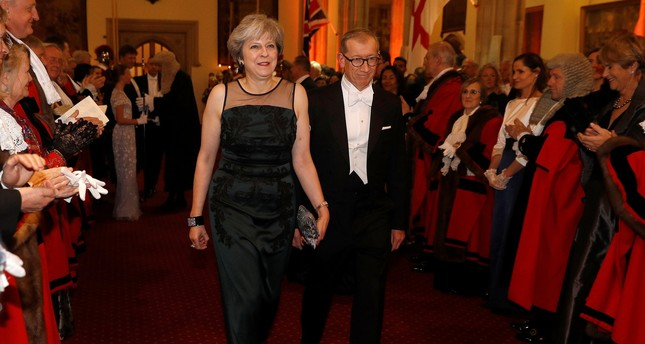 Britain's Prime Minister Theresa May arrives with her husband Philip at the Lord Mayor's Banquet at the Guildhall, in London, Britain November 13, 2017. (Reuters Photo)