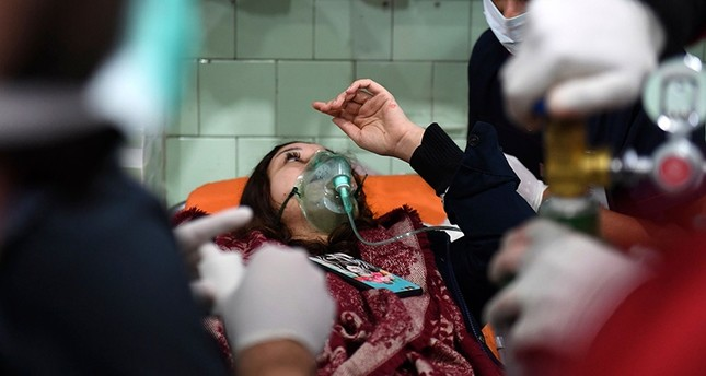 A Syrian woman receives treatment at a hospital in the regime-controlled Aleppo on Nov. 24, 2018. (AFP Photo)