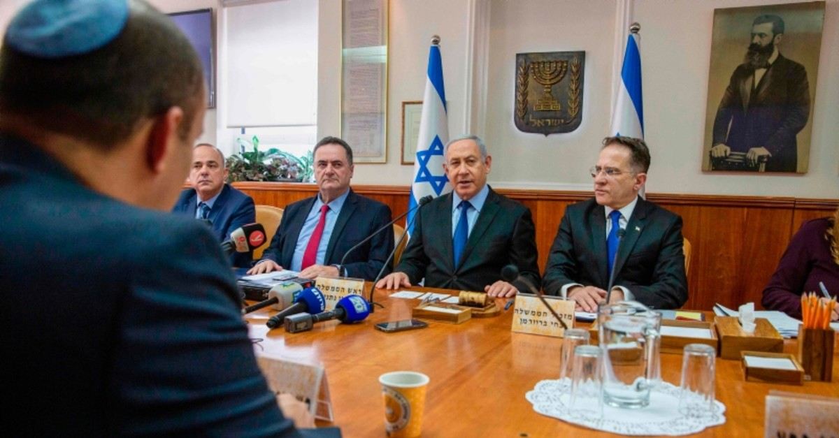 Israeli Prime Minister Benjamin Netanyahu chairs the weekly cabinet meeting at his office in Jerusalem on November 24, 2019. (AFP Photo)