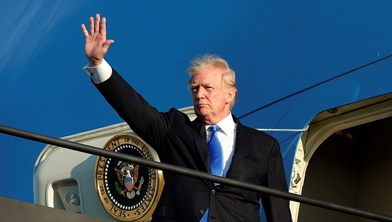 U.S. President Donald Trump waves before his departs from Newark Liberty International airport after a weekend at Trump National Golf Club in Bedminster (Reuters Photo)