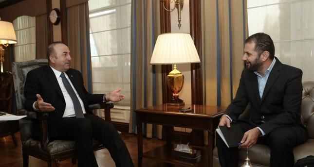 Foreign Minister Mevlüt Çavuşoğlu in an interview with a Politis reporter. (DHA Photo)