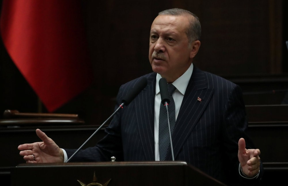 President Recep Tayyip Erdou011fan addresses parliamentarians from the AK Party during a meeting at the Turkish Parliament in Ankara, yesterday.