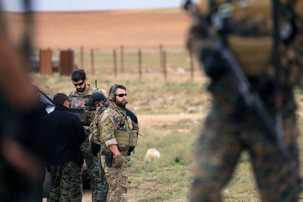Members of the Syrian Democratic Forces (SDF) and U.S. troops are seen during a patrol near the Turkish border in Syria's Hasakah province, Nov. 4.