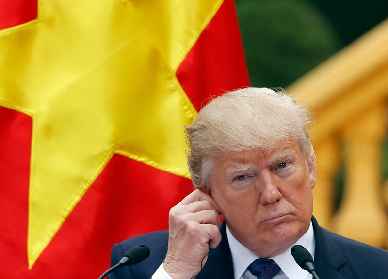 U.S. President Donald Trump attends a press conference at the Presidential Palace in Hanoi, Vietnam ( AP Photo)