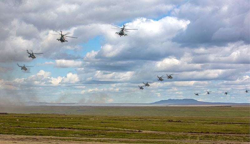 In this photo provided by Russian Defense Ministry Press Service on Tuesday, Sept. 11, 2018, Russian military helicopters fly, in the Chita region, Eastern Siberia, during the Vostok-2018 exercises in Russia. (AP Photo)
