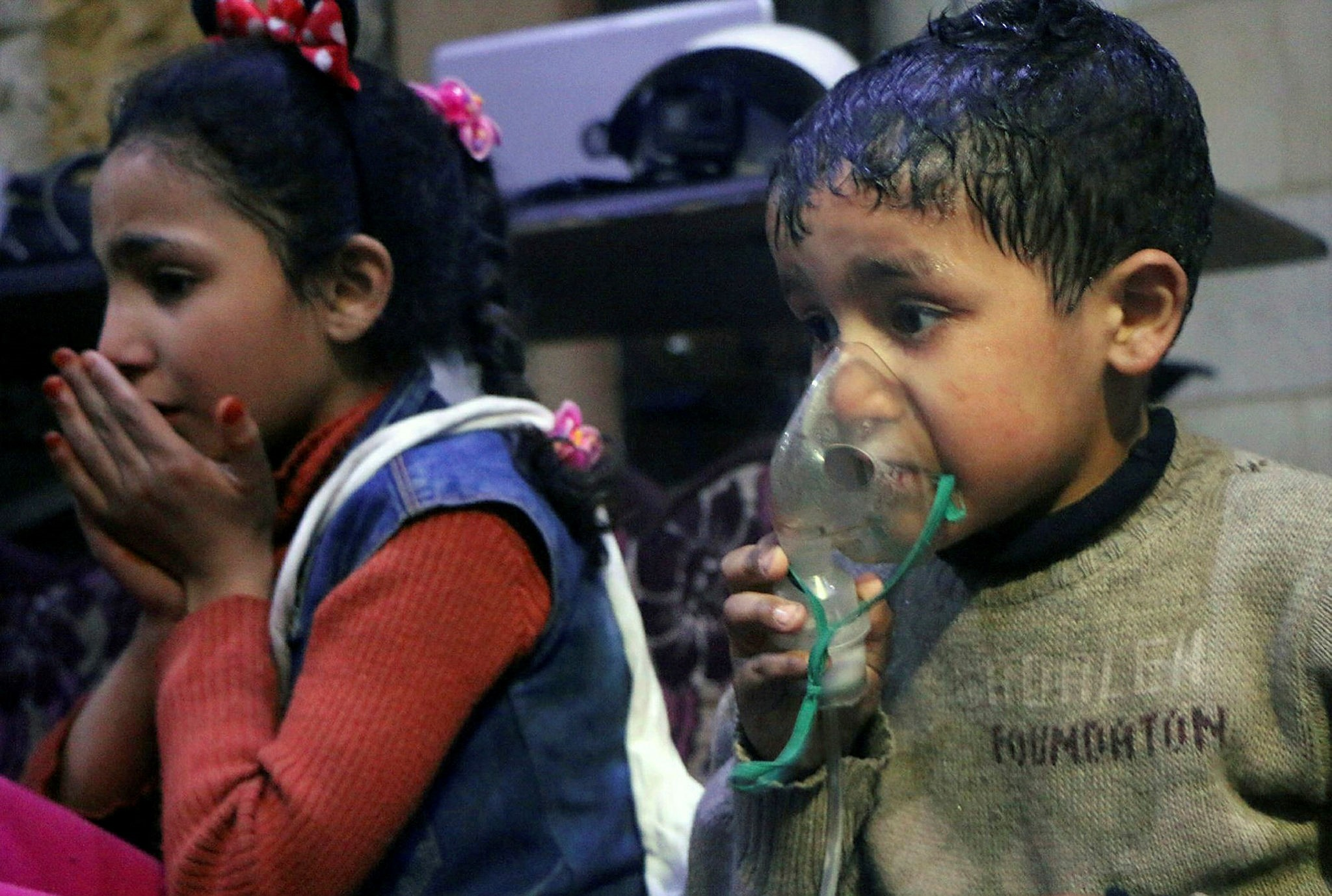 A Syrian child receives oxygen through a respirator following a chemical attack in the opposition-held town of Douma, April 8.