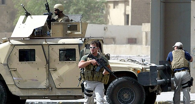 July 2005 file photo shows Blackwater private security contractors near Iranian embassy in Central Baghdad. (AFP/Getty Images)