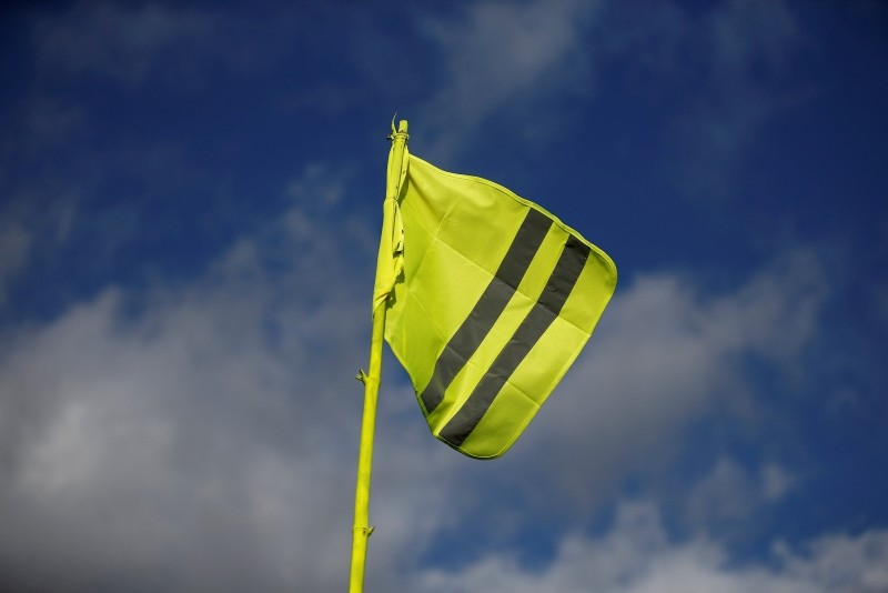 A yellow vest flutters in the sky at a roundabout near the Nantes Atlantique Airport as the ,yellow vests, movement continues, in Bouguenais, France, December 10, 2018. (Reuters Photo)