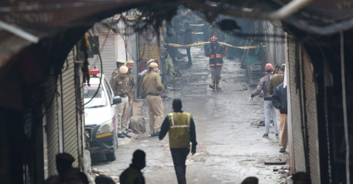 Police officers cordon off the site of a fire in a narrow lane in New Delhi, India, Sunday, Dec. 8, 2019. (AP Photo)