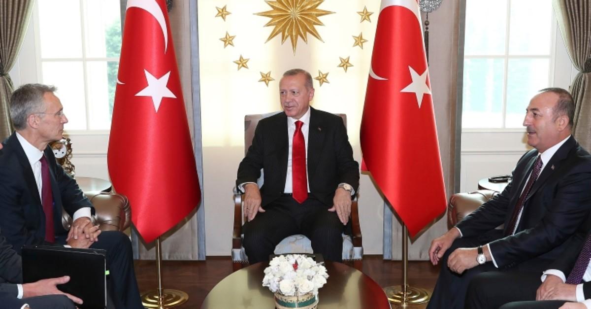 President Recep Tayyip Erdou011fan, right, and NATO Secretary General Jens Stoltenberg speak during a meeting, in Ankara, Turkey, Monday, May 6, 2019. (AP Photo)