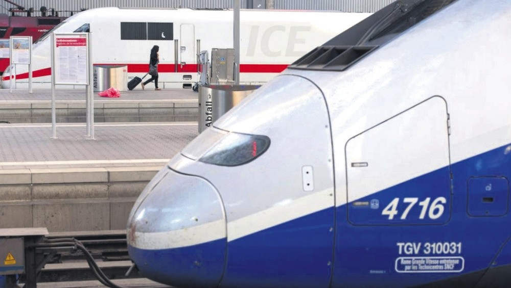 A French high speed train (TGV) made by French train maker Alstom stops next to a German high speed rain (ICE) made by Siemens at Munich's railway station, June 16, 2014.