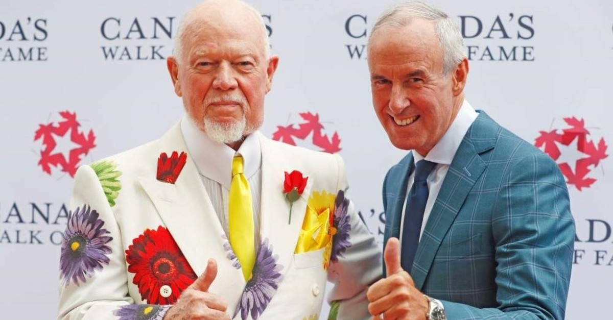 Storied Canadian hockey sportscasters Don Cherry (L) and Ron MacLean unveil their 2015 Canada's Walk of Fame star on King St in Toronto, Ontario, Canada, July 25, 2016. (Reuters Photo)