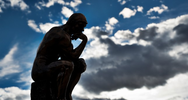 """The Thinker,"" a bronze sculpture by Auguste Rodin."