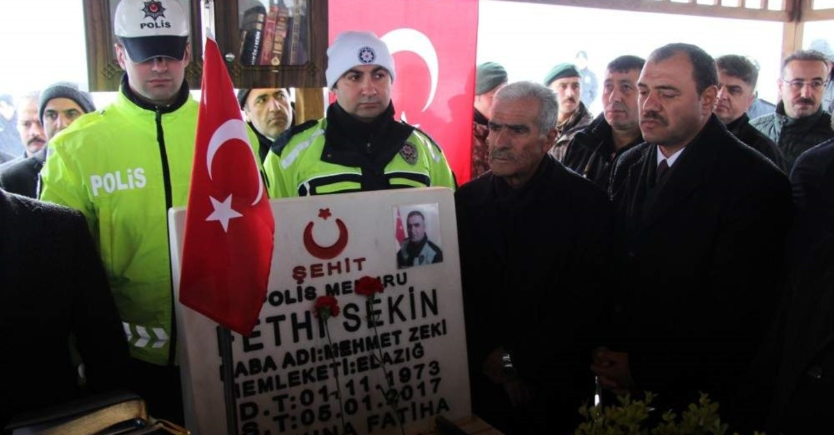 People gather at Fethi Sekin's grave to remember the policeman, Elaz??, Jan. 5, 2020. (AA Photo)