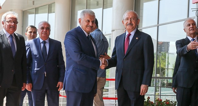 Prime Minister Binali Yıldırım visited main opposition Republican People's Party (CHP) chairman Kemal Kılıçdaroğlu at the party headquarters in Ankara. (AA Photo)