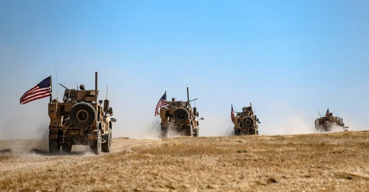 A U.S. military convoy takes part in a joint patrol with Turkish troops in the Syrian village of al-Hashisha along the border with Turkey, Sept. 8, 2019.