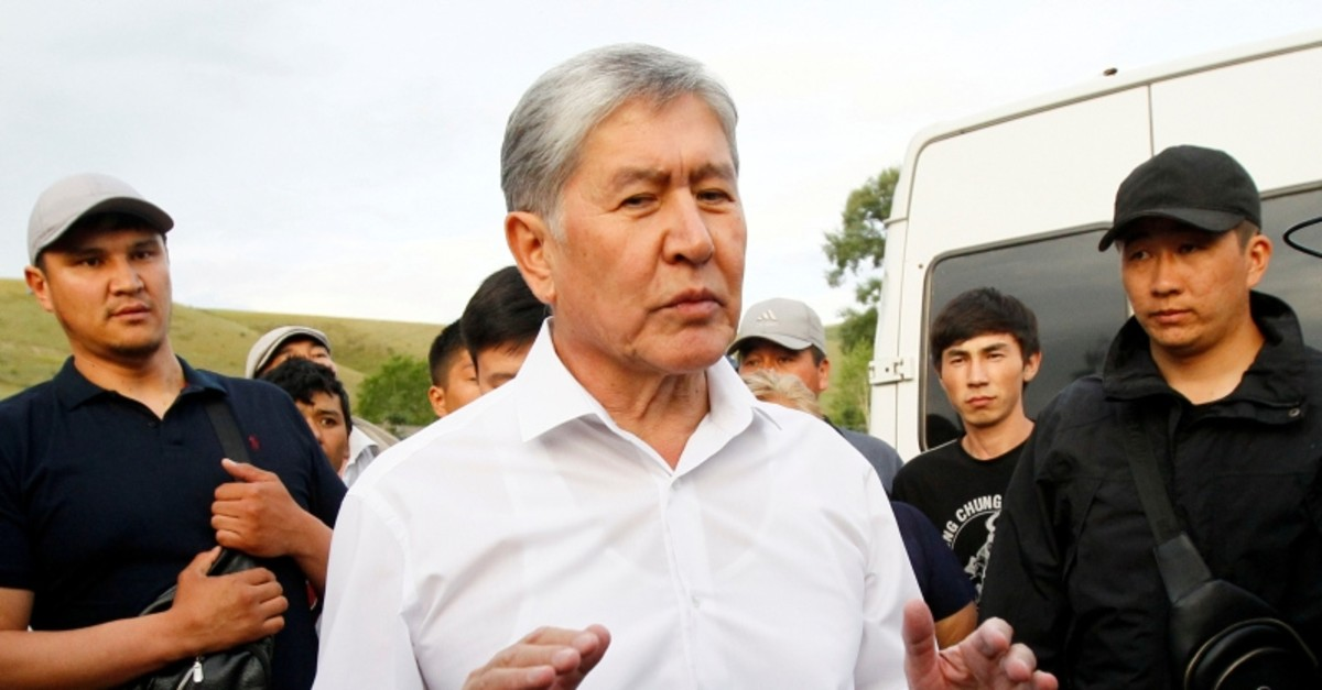 Kyrgyz former President Almazbek Atambayev, who was stripped of legal immunity after a parliamentary vote, and his supporters attend a meeting with journalists in the village of Koy-Tash near Bishkek, Kyrgyzstan June 27, 2019 (Reuters Photo)