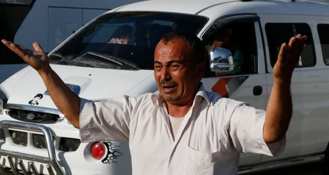 Syrian refugee Ahmed el Abdullah Ibrahim cries as he returns home in Tal Abyad after 5 years AA Photo