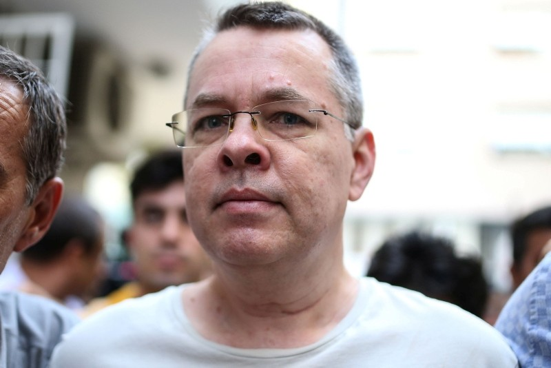In this file photo taken on July 25, 2018 US pastor Andrew Brunson escorted by Turkish plain clothes police officers arrives at his house on July 25, 2018 in Izmir. (AFP Photo)
