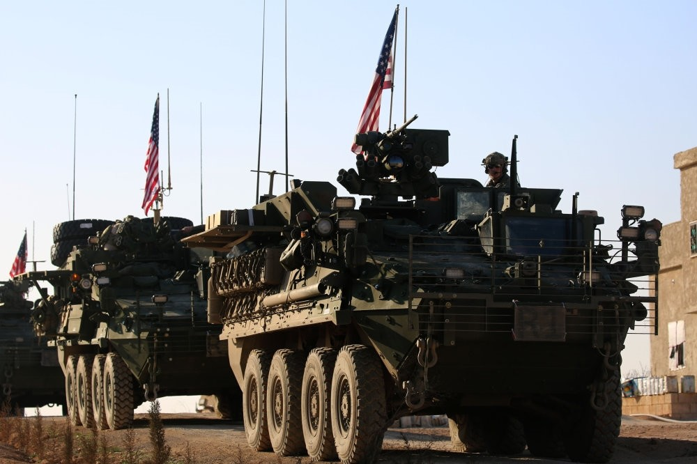 A convoy of U.S. armored vehicles drives near the village of YalanlI, on the western outskirts of the northern Syrian city of Manbij, March 5, 2017.