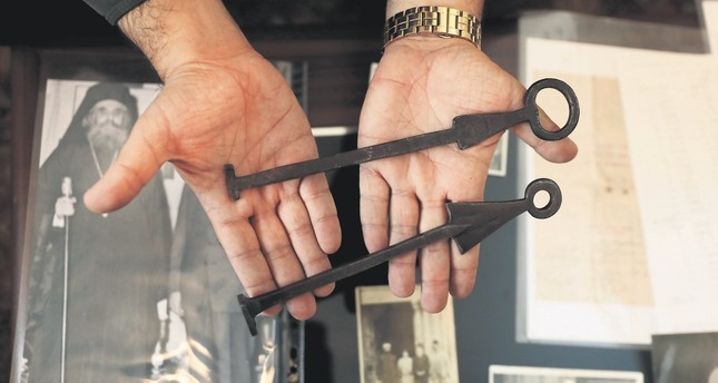 Adeeb Joudeh, a Muslim, displays the ancient keys to the Church of the Holy Sepulchre.