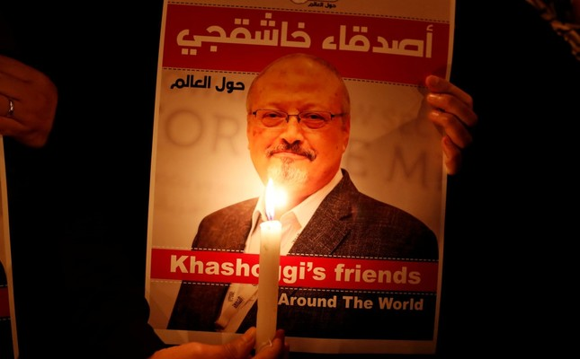 A demonstrator holds a poster with a picture of journalist Jamal Khashoggi outside the Saudi Consulate in Istanbul, Oct. 25.