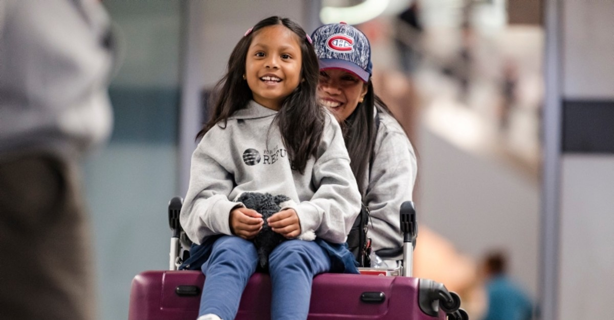Vanessa Rodel and her 7-year-old daughter Keana exit Lester B. Pearson Airport in Toronto on Monday, March 25, 2019. (The Canadian Press via AP)