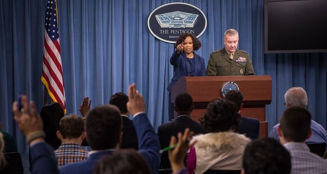 Dana W. White, chief Pentagon spokesperson, and Lt. Gen. Kenneth F. McKenzie, the Joint Staff director, brief the press at the Pentagon in Washington, Oct. 19, 2017 (DoD Photo)