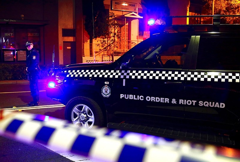 A policeman stands on a street that has been blocked to the public after Australian counter-terrorism police arrested four people in raids late on Saturday (Reuters Photo)