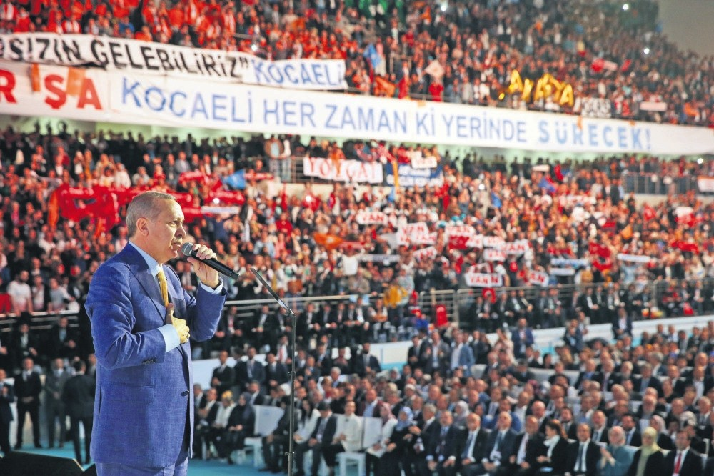 President Recep Tayyip Erdou011fan addresses party members and the public at his party's third emergency congress held Sunday in the capital Ankara.