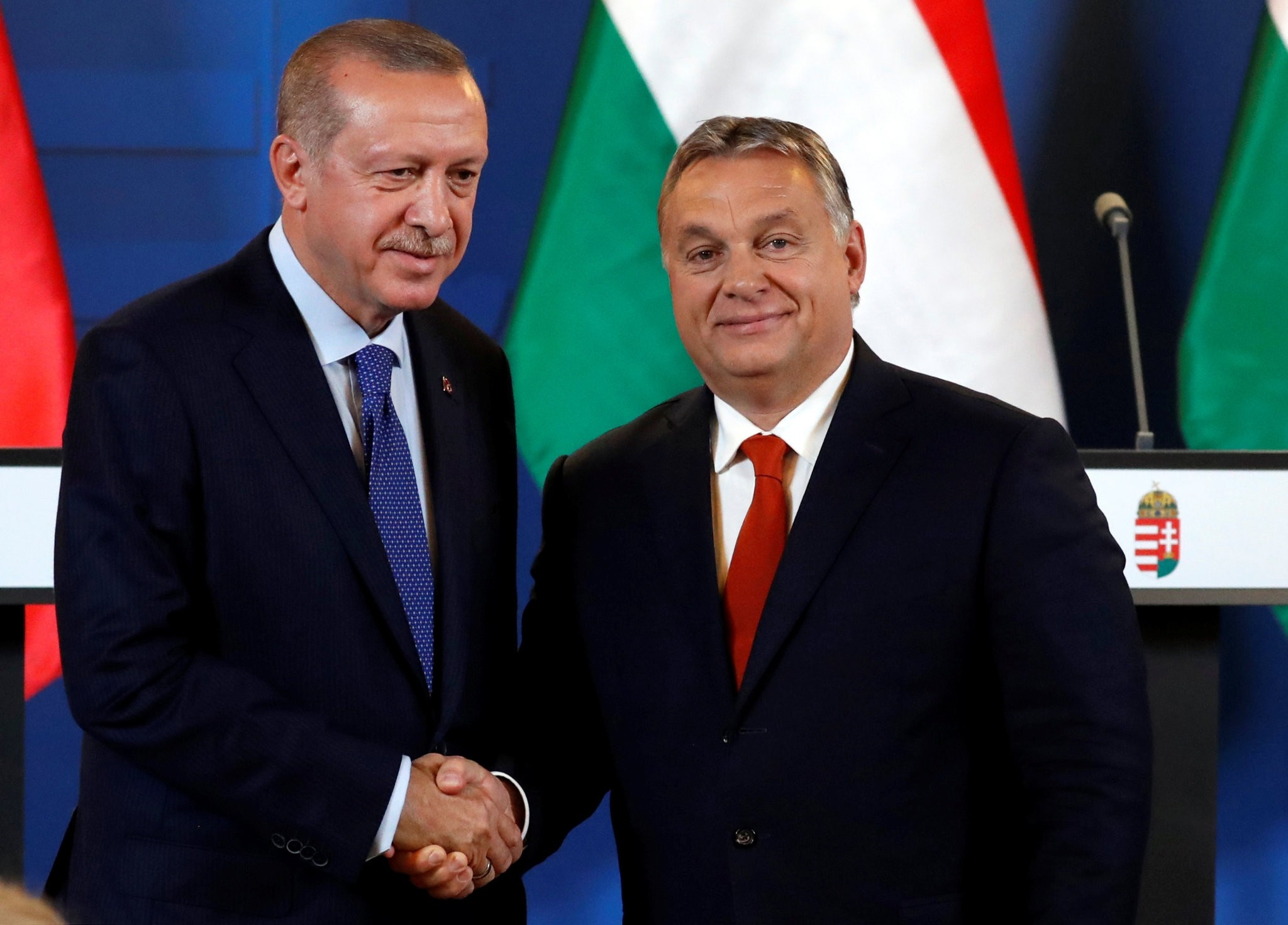 President Recep Tayyip Erdou011fan and Hungarian Prime Minister Viktor Orban shake hands after a joint news conference in Budapest, Oct. 8.