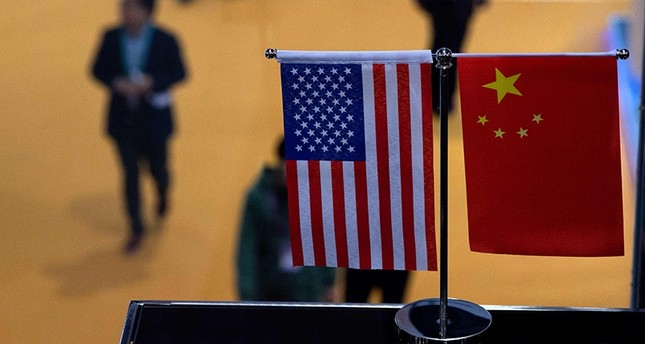 In this file photo taken on Nov. 6, 2018, a Chinese and U.S. flag are displayed at a booth during the first China International Import Expo (CIIE) in Shanghai. (AFP Photo)