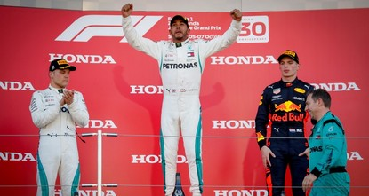 Hamilton moves closer to 5th title with Japan victory